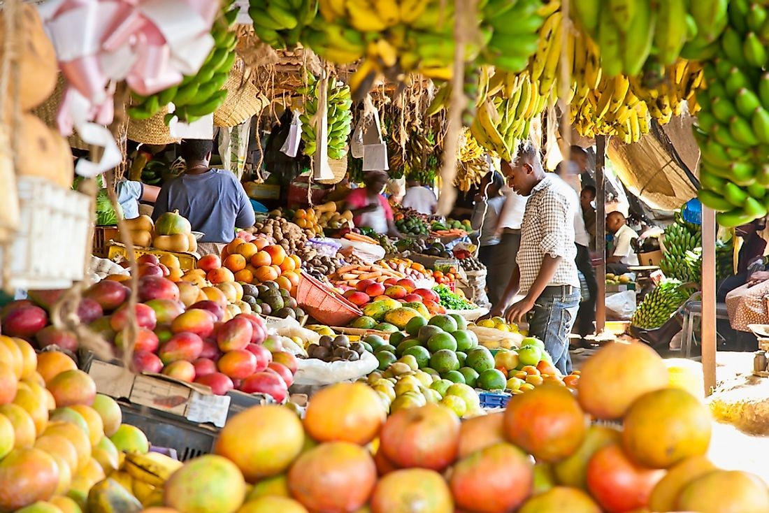 Street vendors selling local fruit in Nairobi, Kenya.  Editorial credit: Aleksandar Todorovic / Shutterstock.com.