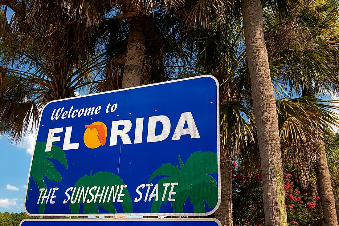 "A welcome sign proclaiming Florida as the ""sunshine state""."