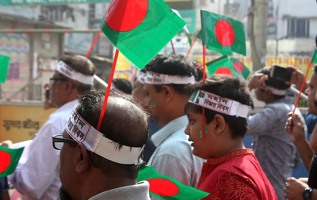 Bangladeshi men marching in the Victory Day Rally. Editorial credit: Brand Kidz / Shutterstock.com.