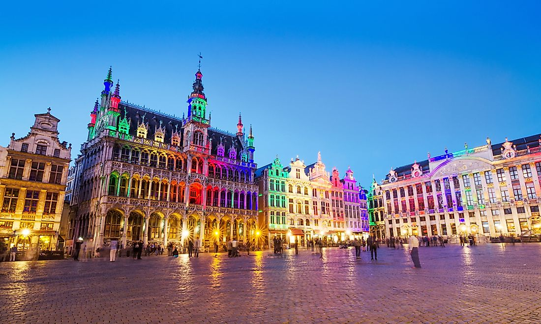 The Grand Palace in Brussels lit up with multi-colored lights.