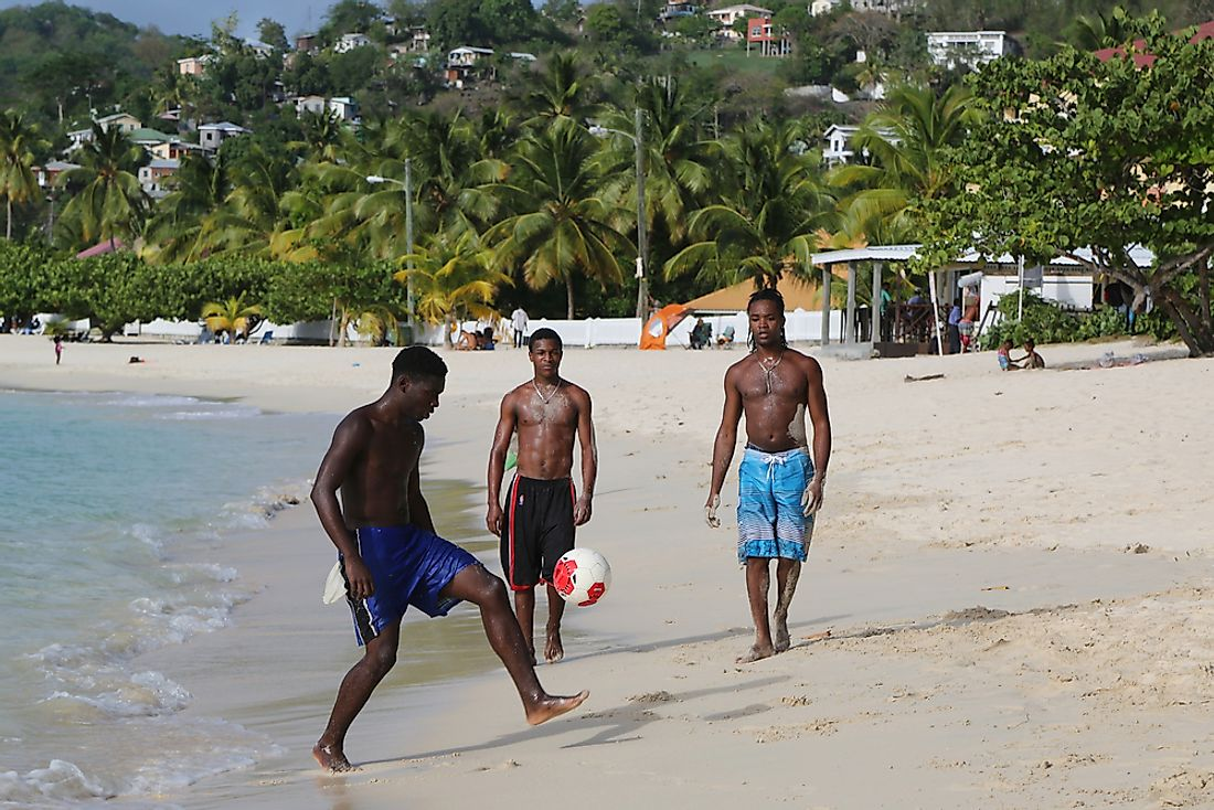Men play soccer on the beach in Grenada. Editorial credit: Leonard Zhukovsky / Shutterstock.com.