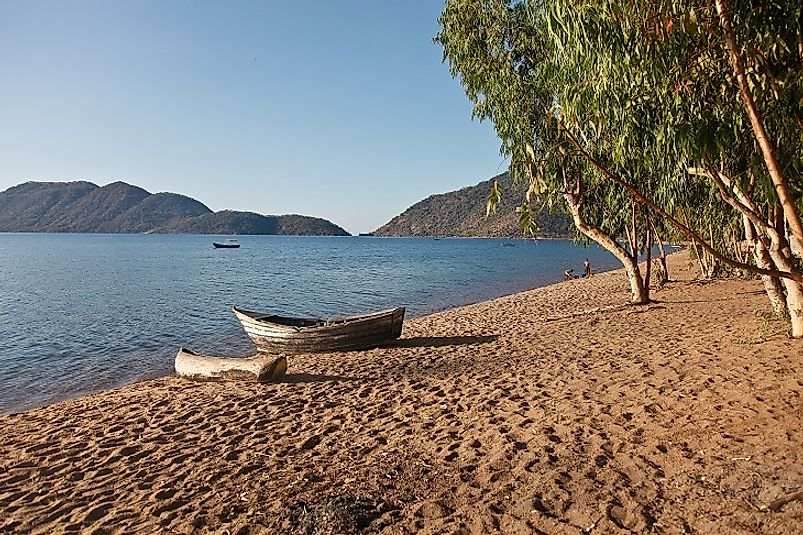 Shores of Lake Malawi with traditional canoes on the beach.