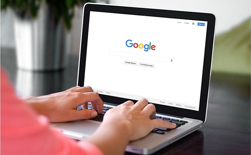 A woman is typing on Google search engine from a laptop. Editorial credit: Castleski / Shutterstock.com