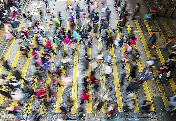 Busy pedestrian crosswalk from above in Hong Kong