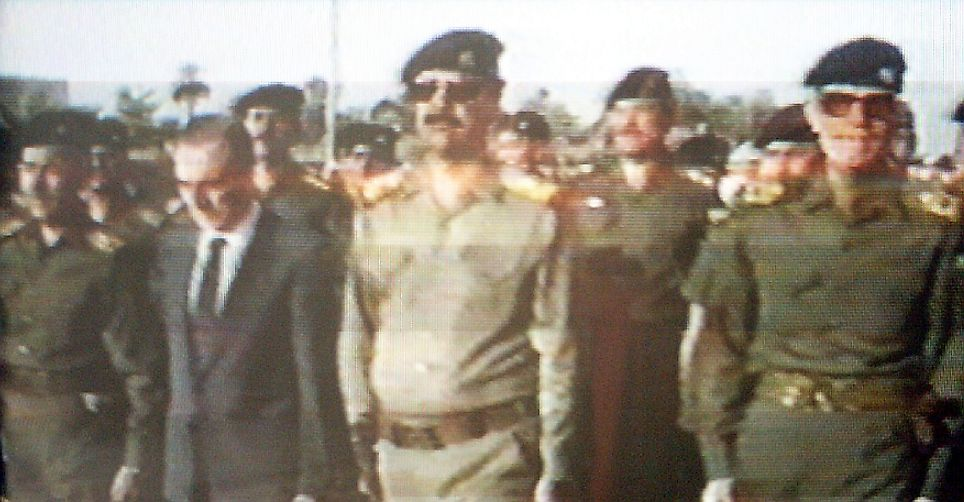 Iraqi and Syrian Ba'athist leaders during the funeral of Michel Aflaq in 1989.