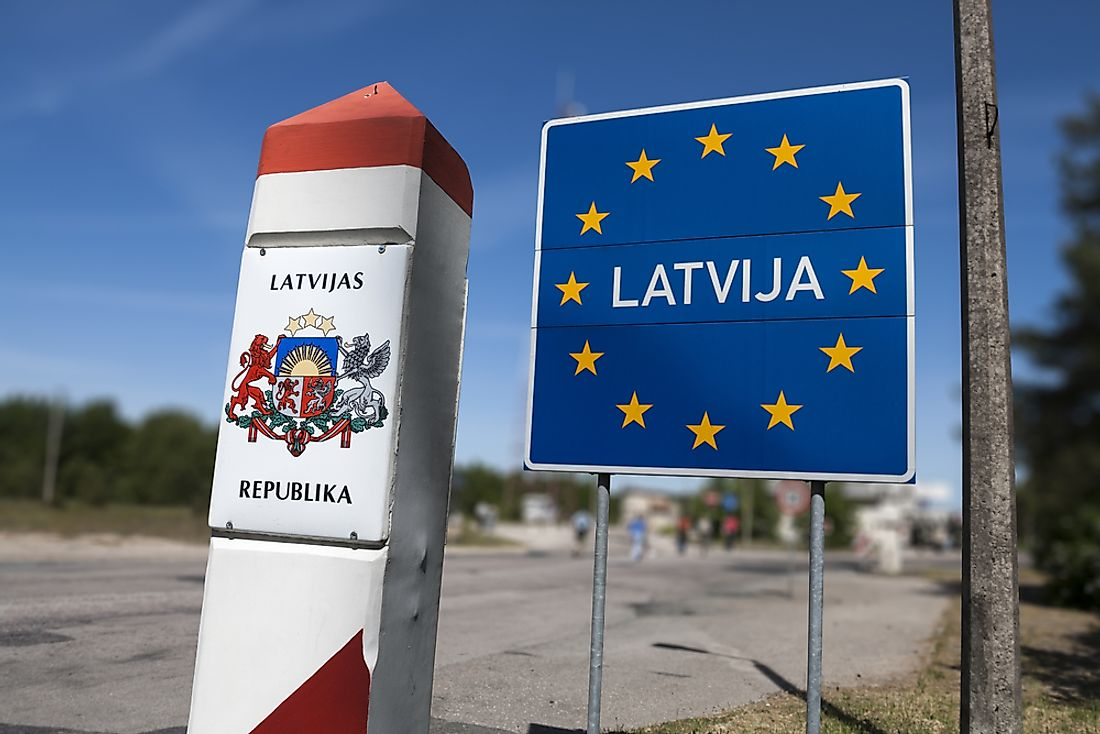 Sign demarcating the boundary between Latvia and Lithuania.