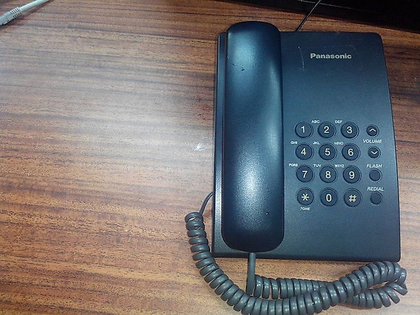 A fixed telephone at a desk.