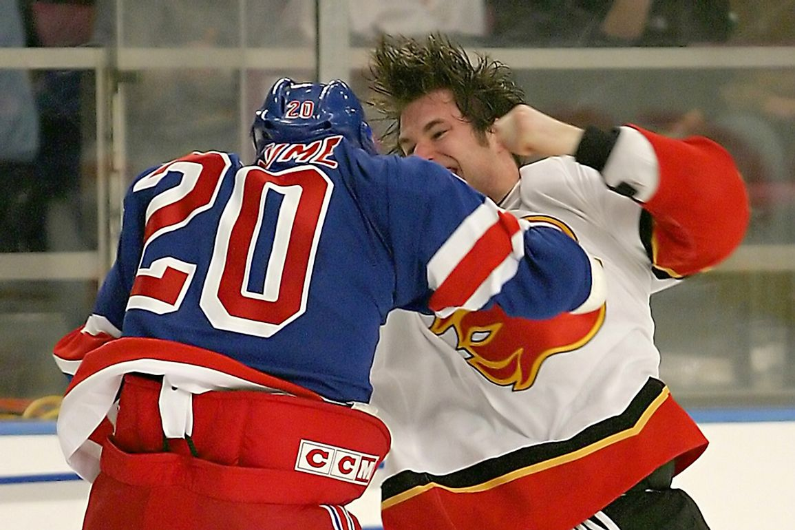Fight breaks out between Pascal Rheaume (New York Rangers) and Steve Montador (Calgary Flames). Editorial credit: Patrick Tuohy / Shutterstock.com
