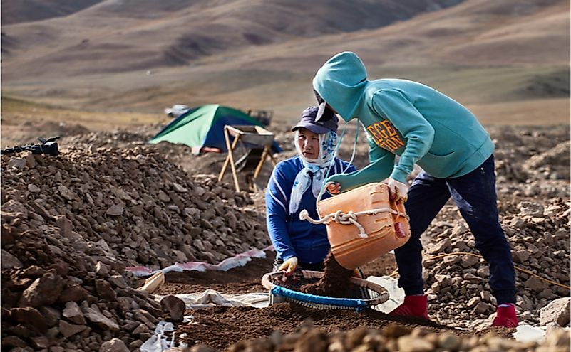 Mongolians manually extract gold from a dried river bed. Editorial credit: J_K / Shutterstock.com