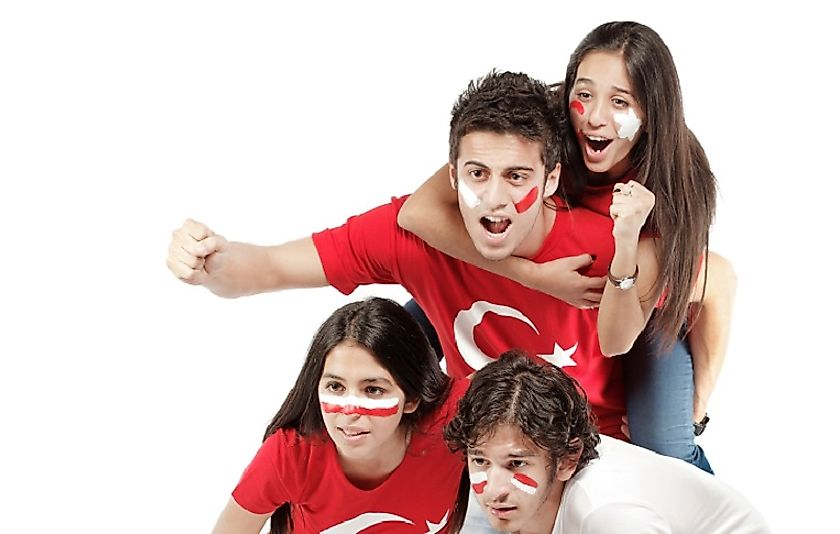 Turkish siblings watching their National Football Team on television.
