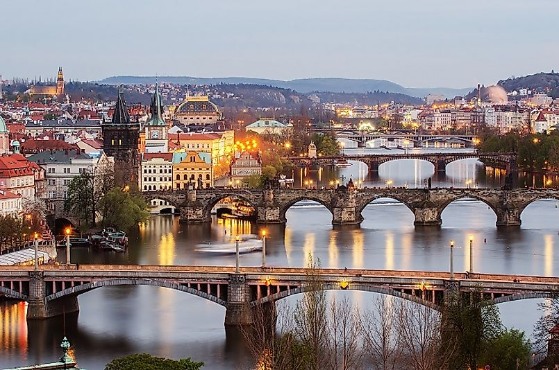 Beautiful view of Old Prague in springtime, with its iconic bridges stretching across the Vltava River.