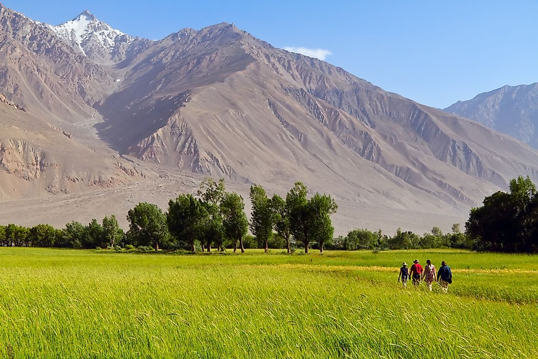 Tourists explore the Afghan Mountains.