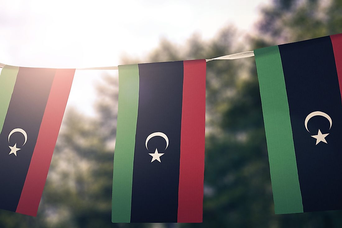 The flag of Libya on a banner.