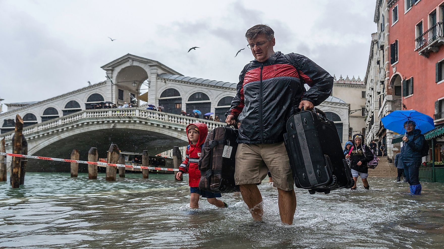 Tourists in Venice during a flood. Editorial credit: Ihor Serdyukov / Shutterstock.com.