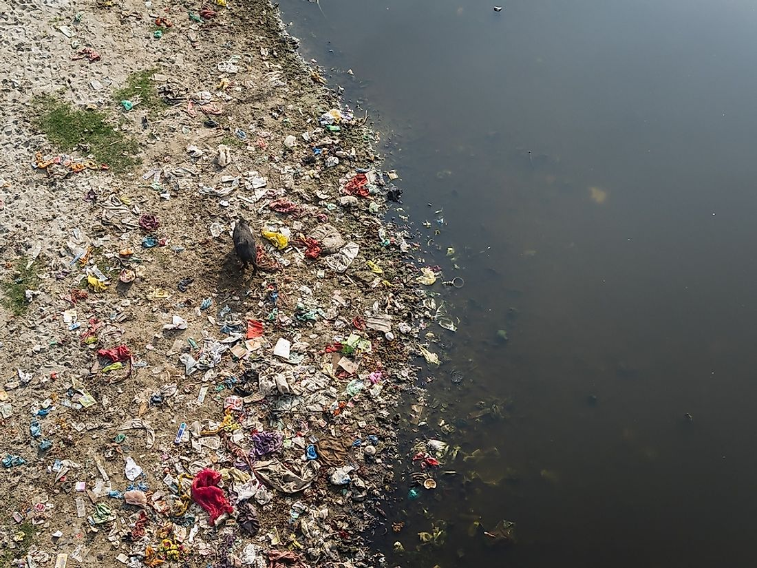 In several places along its course, the Citarum River is so heavily loaded with wasters that its water is hardly visible.