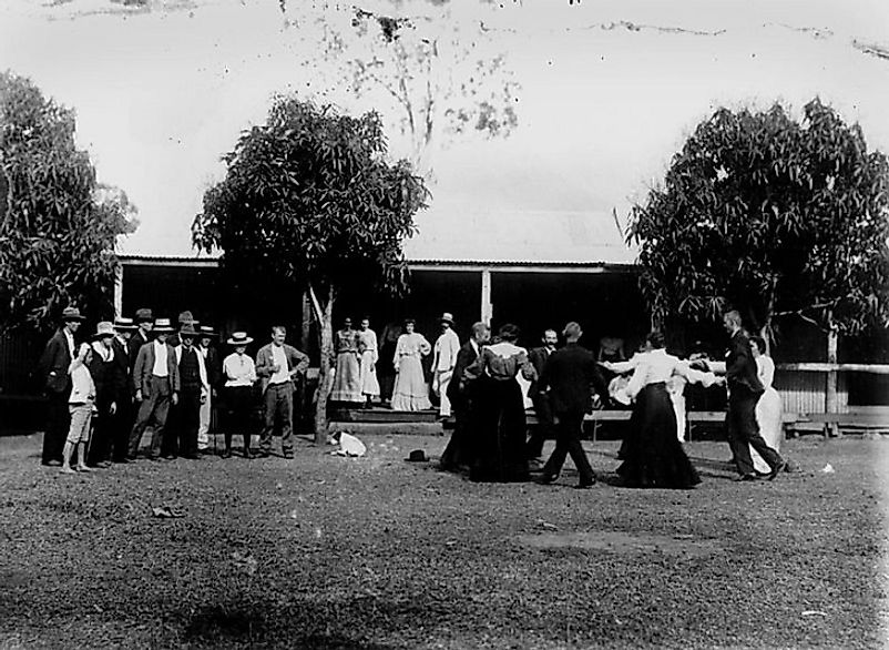 A social dance on a village commons in the early 20th Century.