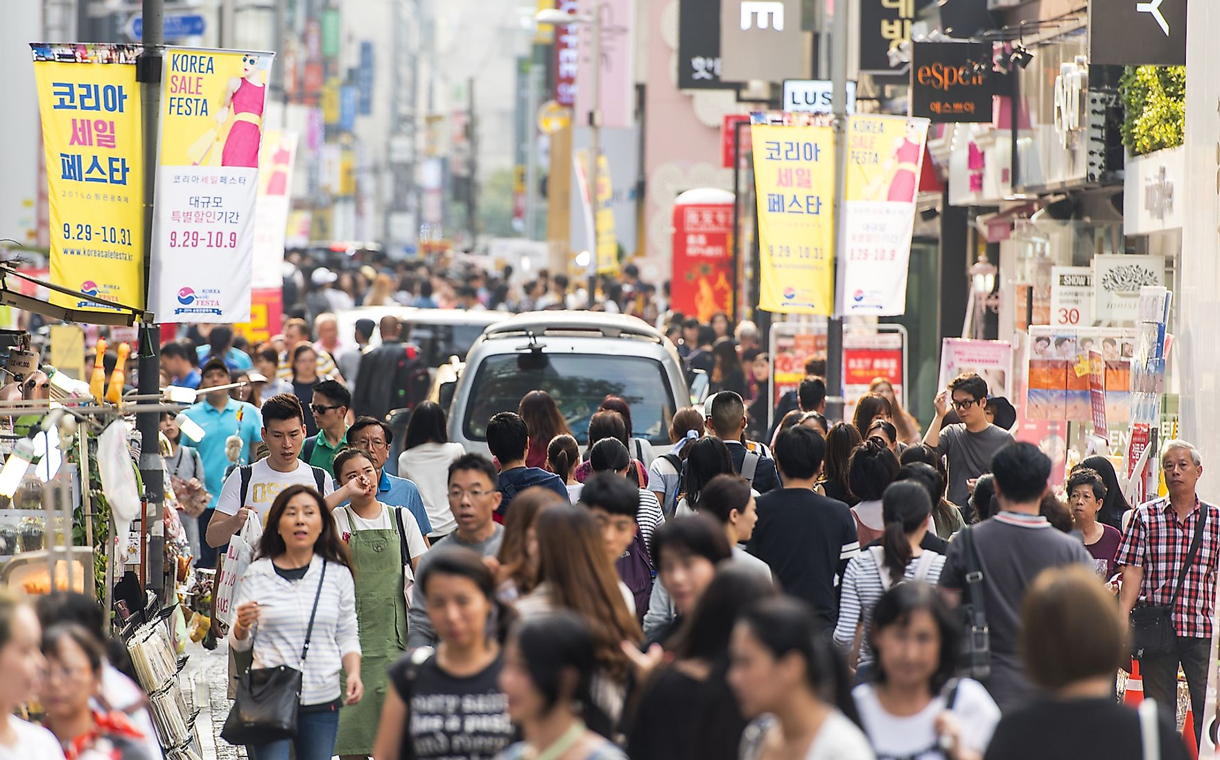 Young people walk the streets of Seoul, South Korea. Savvapanf Photo / Shutterstock.com.