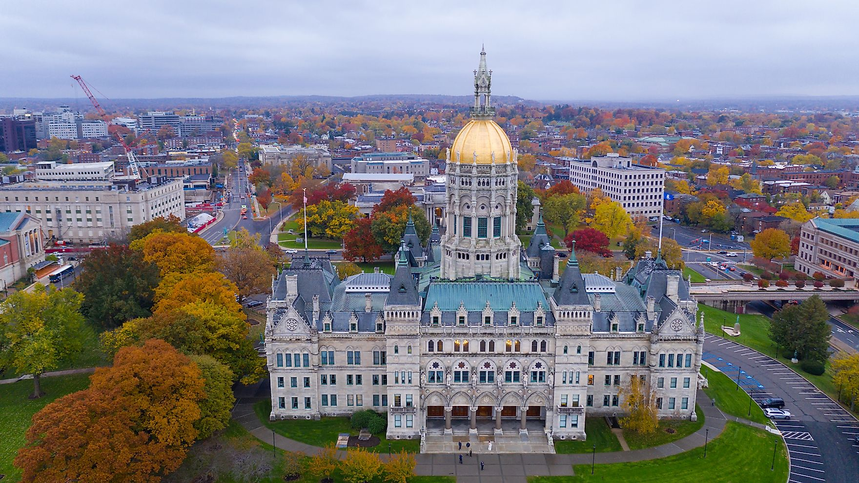 An aerial view focusing on the Connecticut State House with blazing fall color in the trees around Hartford.