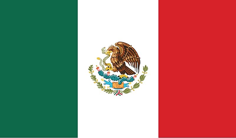 The flag of Mexico is a tricolor of green, white, and red, featuring the Mexican Coat of Arms.