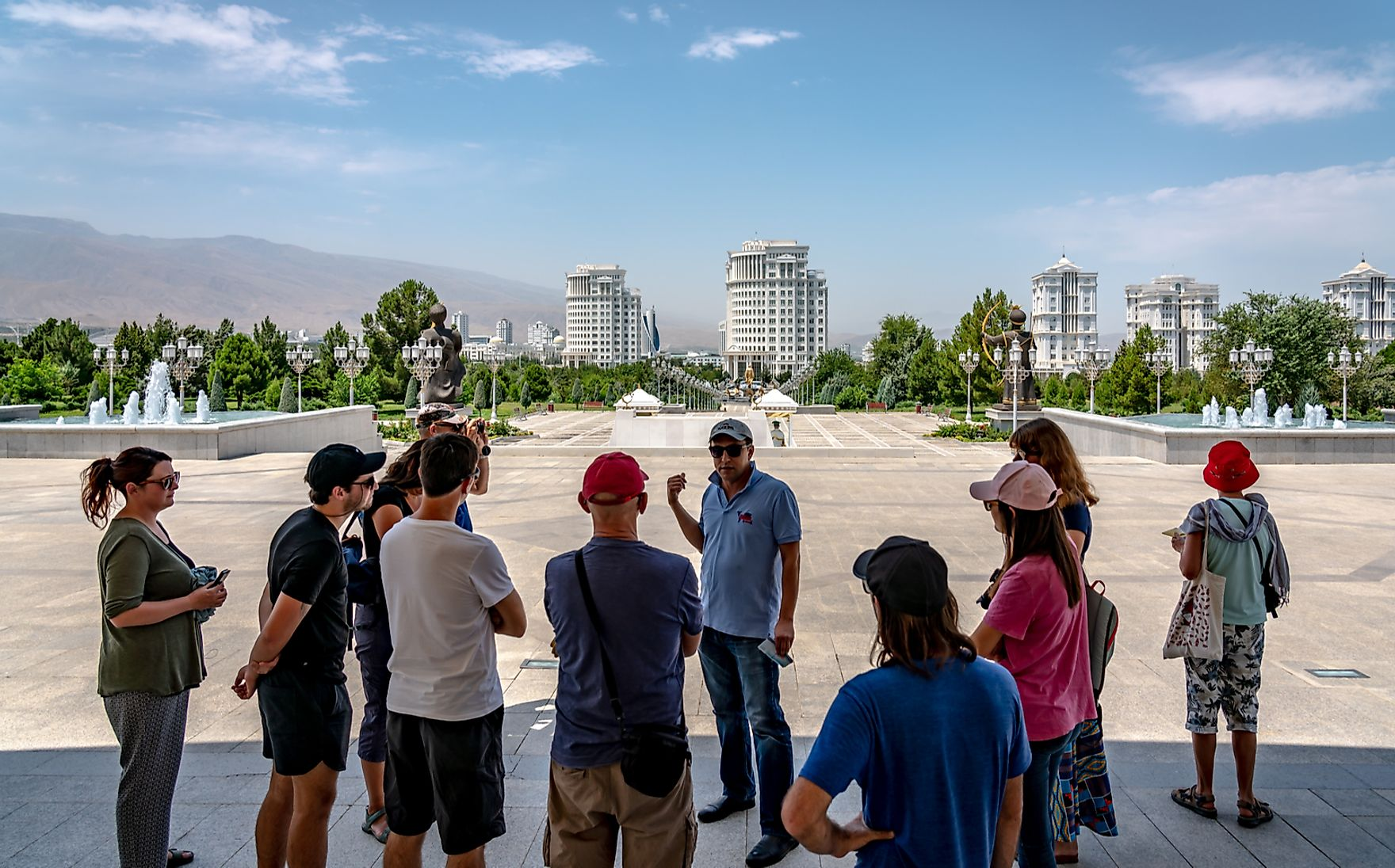 A group of tourists go on a spacious sightseeing adventure around Ashgabat. LMspencer / Shutterstock.com.