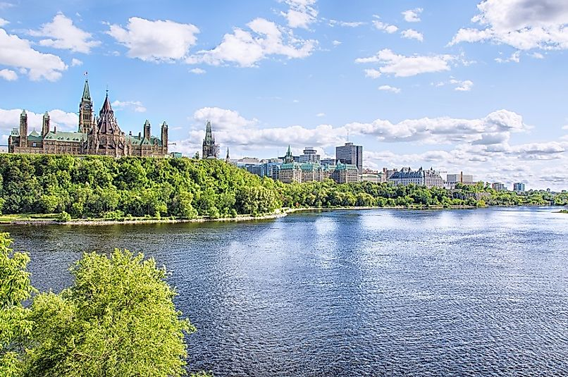 Canadian Parliament building along the banks of the Ottawa River.