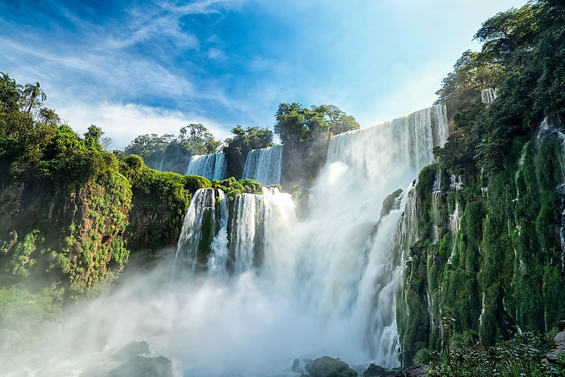 The massive, crescent-shaped Iguazu Falls are situated in a semi-circular loop along the Brazilian-Argentine border on the Iguazu River.