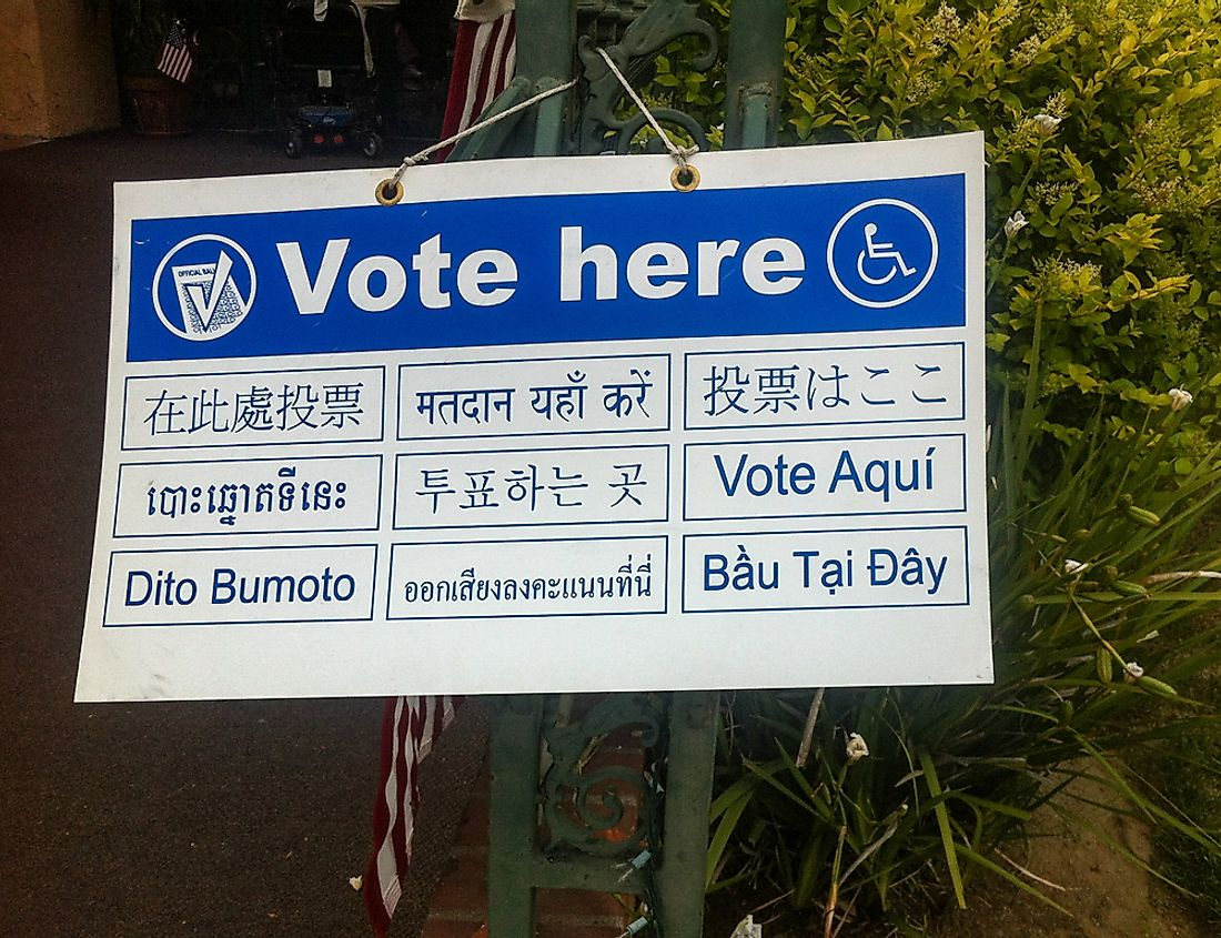 A voting sign in Los Angeles in multiple languages. Editorial credit: Underawesternsky / Shutterstock.com.