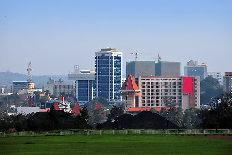 Suburban fields meet tall skyscrapers along the outskirts of Kampala.