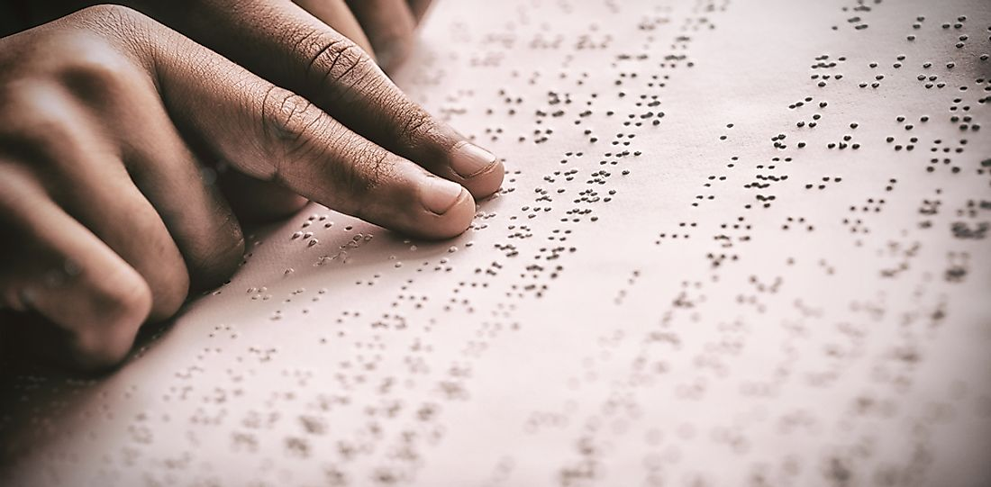 Braille is a tactile system of raised dots felt with the reader's finger.