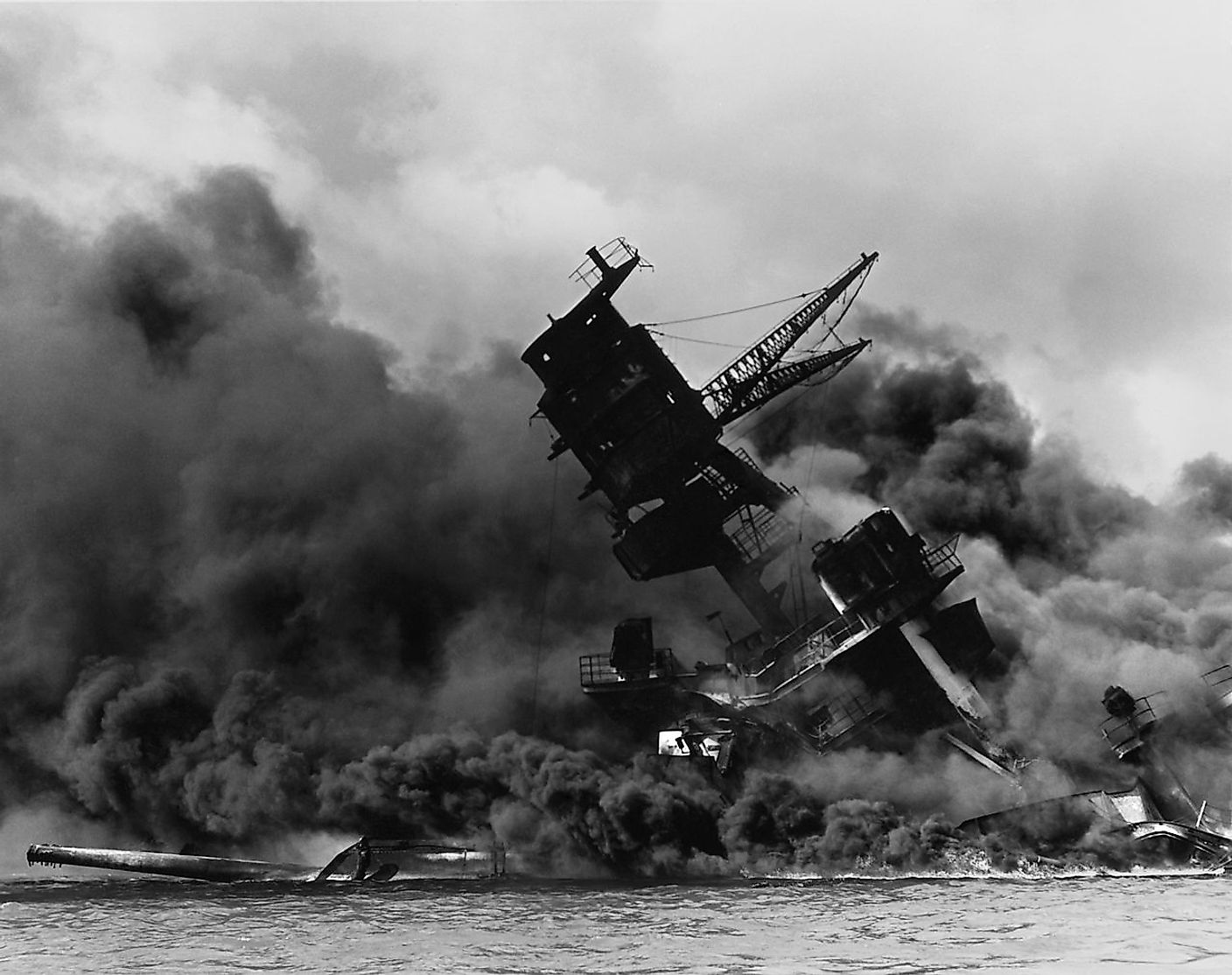 The USS Arizona (BB-39) burning after the Japanese attack on Pearl Harbor.
