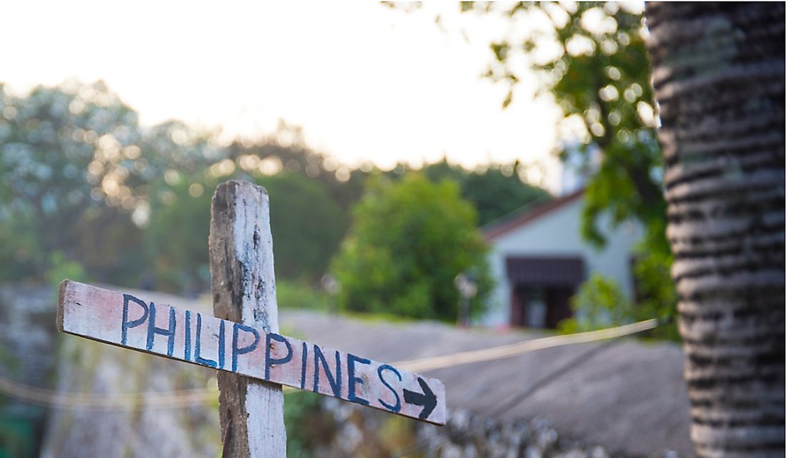 Signpost pointing towards the Philippines.