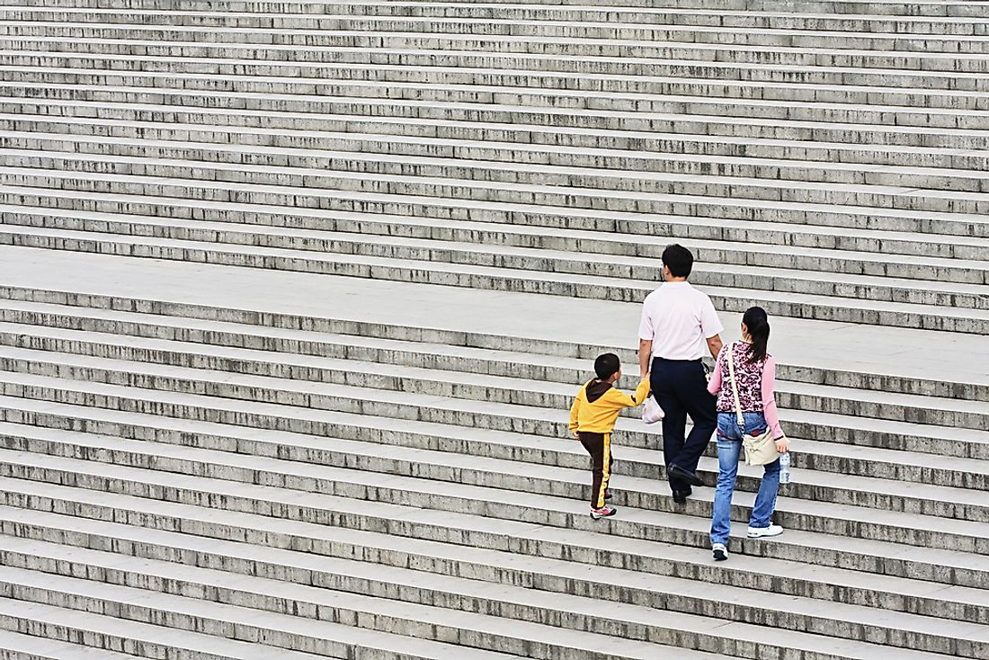 A family with one child in China. Editorial credit: TonyV3112 / Shutterstock.com.