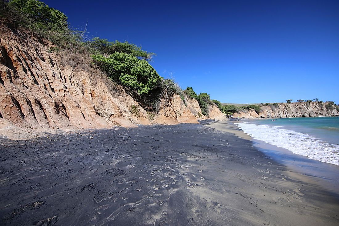 Black Sand Beach, in Vieques, Puerto Rico. Small organisms in the nearby bay's waters turn them neon and blue, prompting the name Bioluminescent Bay.