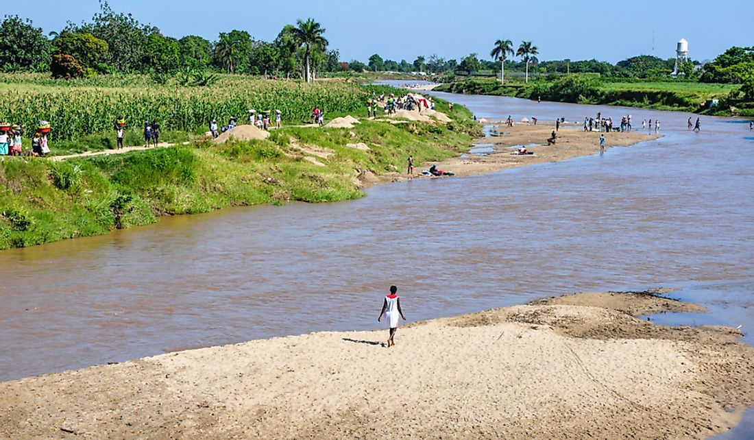People crossing the Dajabón River between Haiti and the Dominican Republic. Editorial credit: Sandra Foyt / Shutterstock.com