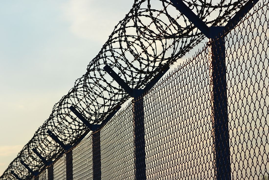 Barbed wire fences are important security features at private prisons.