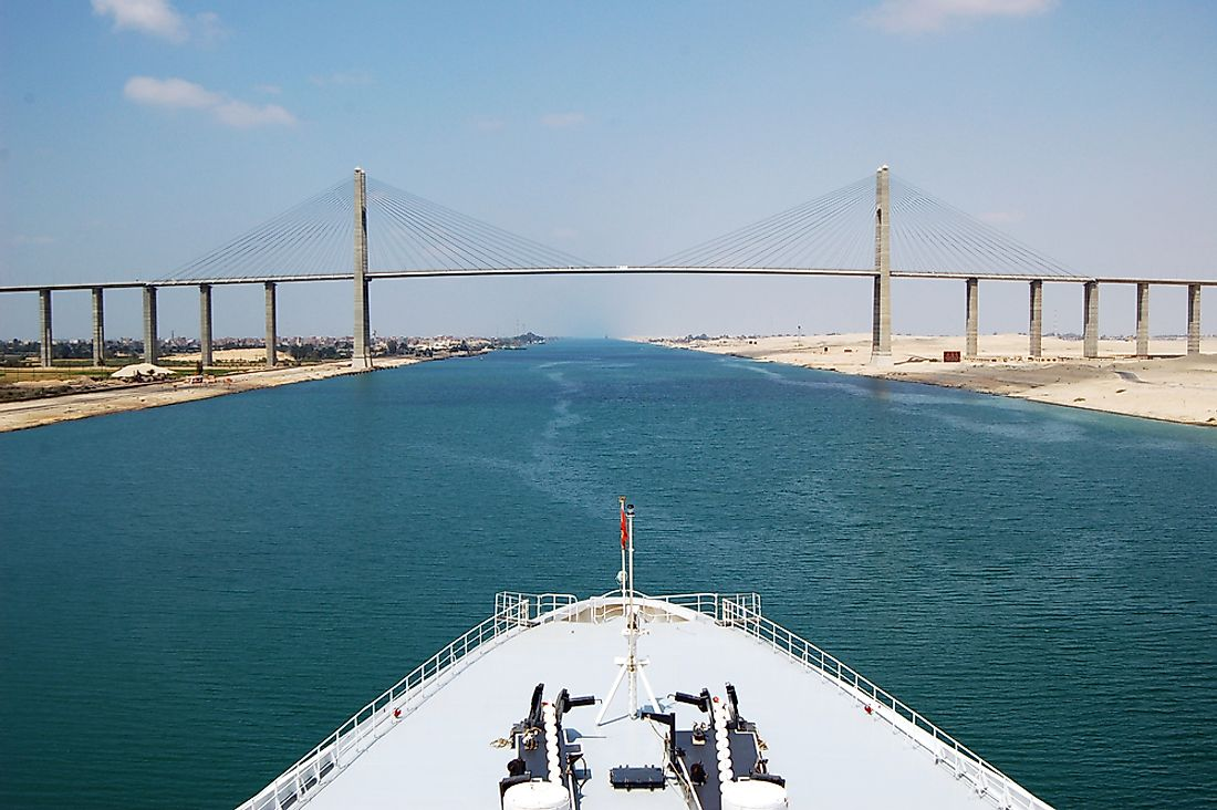A cruise ship passes through the Suez Canal.
