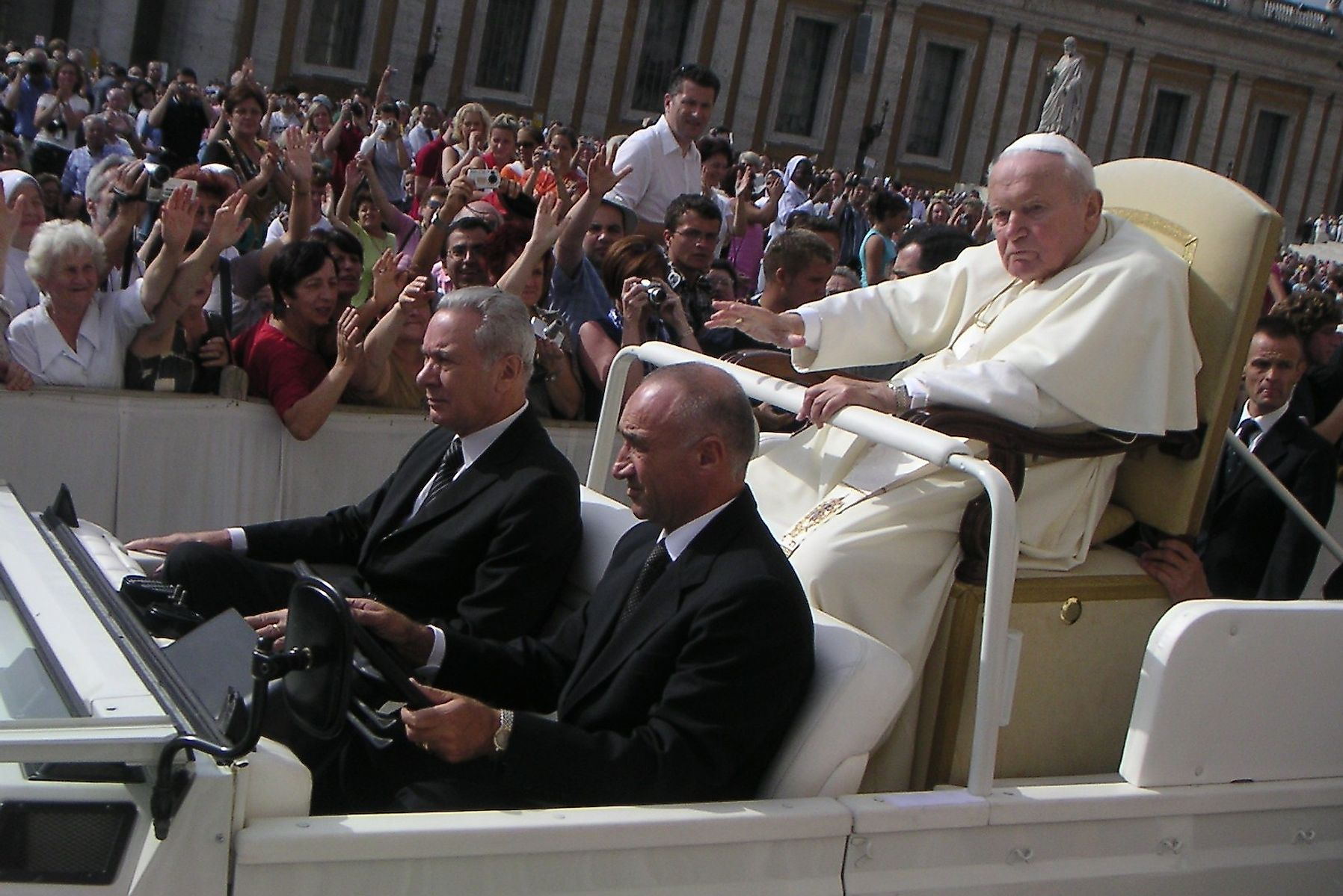 Pope John Paul II, one of longest serving popes (1978-2005), riding the Popemobile in St. Peter's Square in 2004.