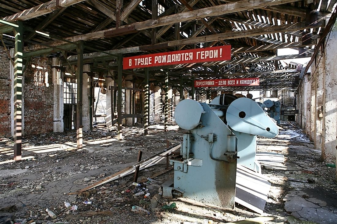 "An old factory in the Soviet Union showing slogans from ""perestroika""."