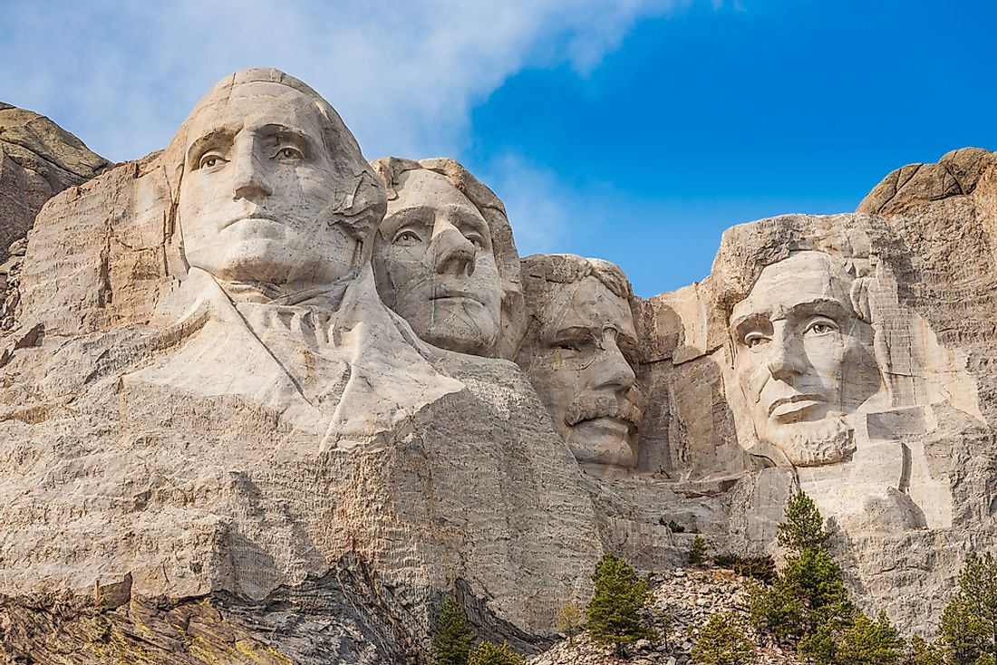 Mount Rushmore sculptures of past-presidents George Washington, Thomas Jefferson, Theodore Roosevelt, and Abraham Lincoln.