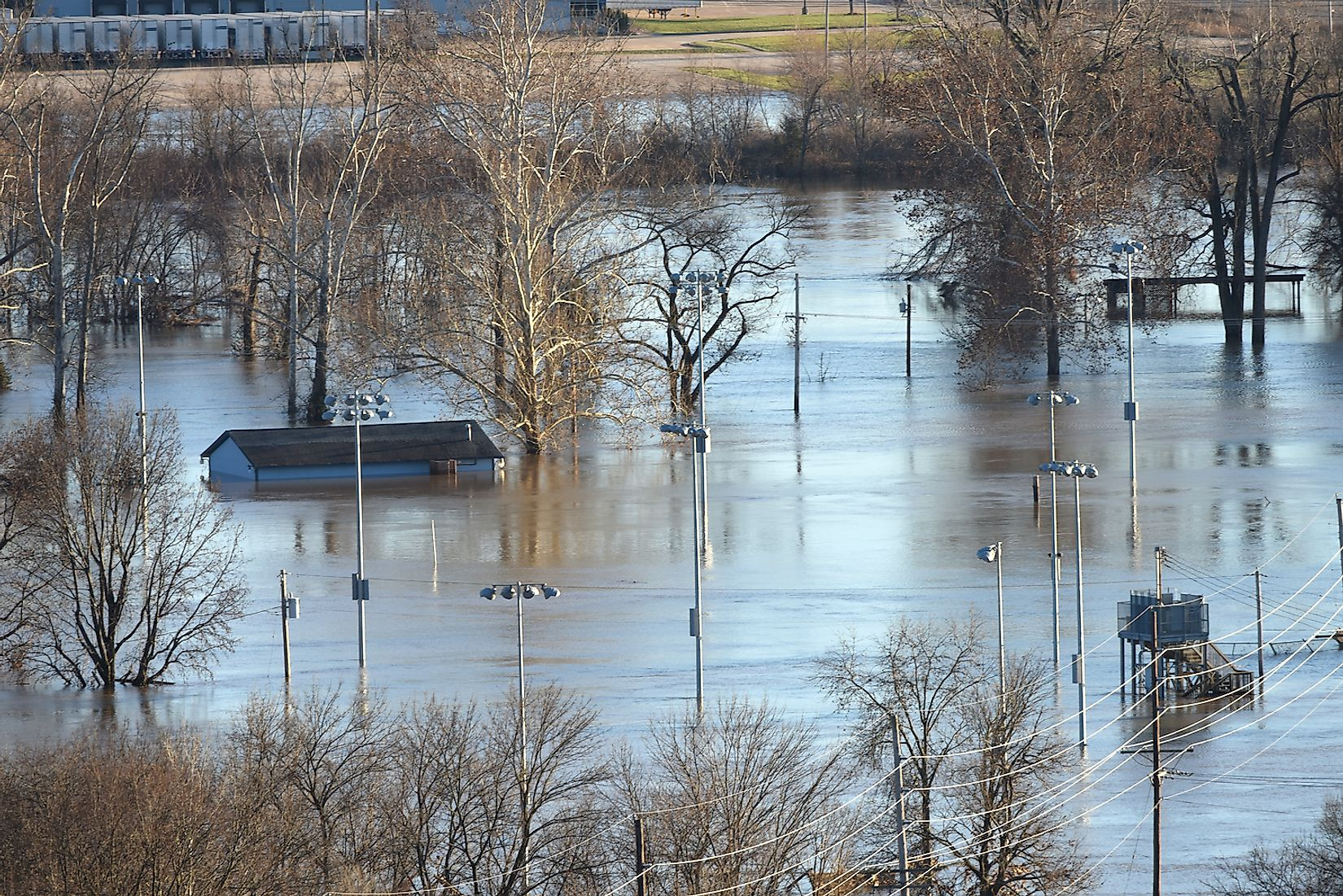 Flood waters nearly submerge house in Valley Park in old town Fenton, Valley Park, Missouri. Image credit: Gino Santa Maria/Shutterstock.com