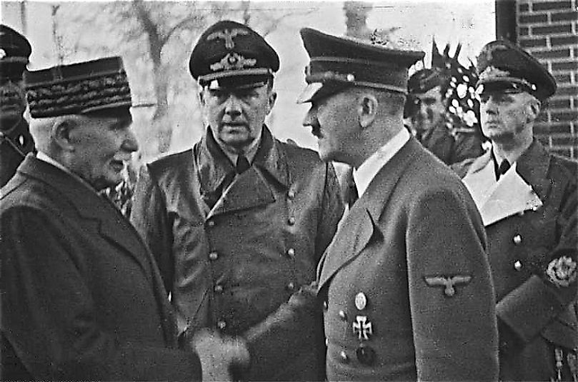 "Nazi German leader Adolf Hitler meeting with his French ""client"" state's leader, Philippe Pétain, after France fell to the Nazis in 1940."