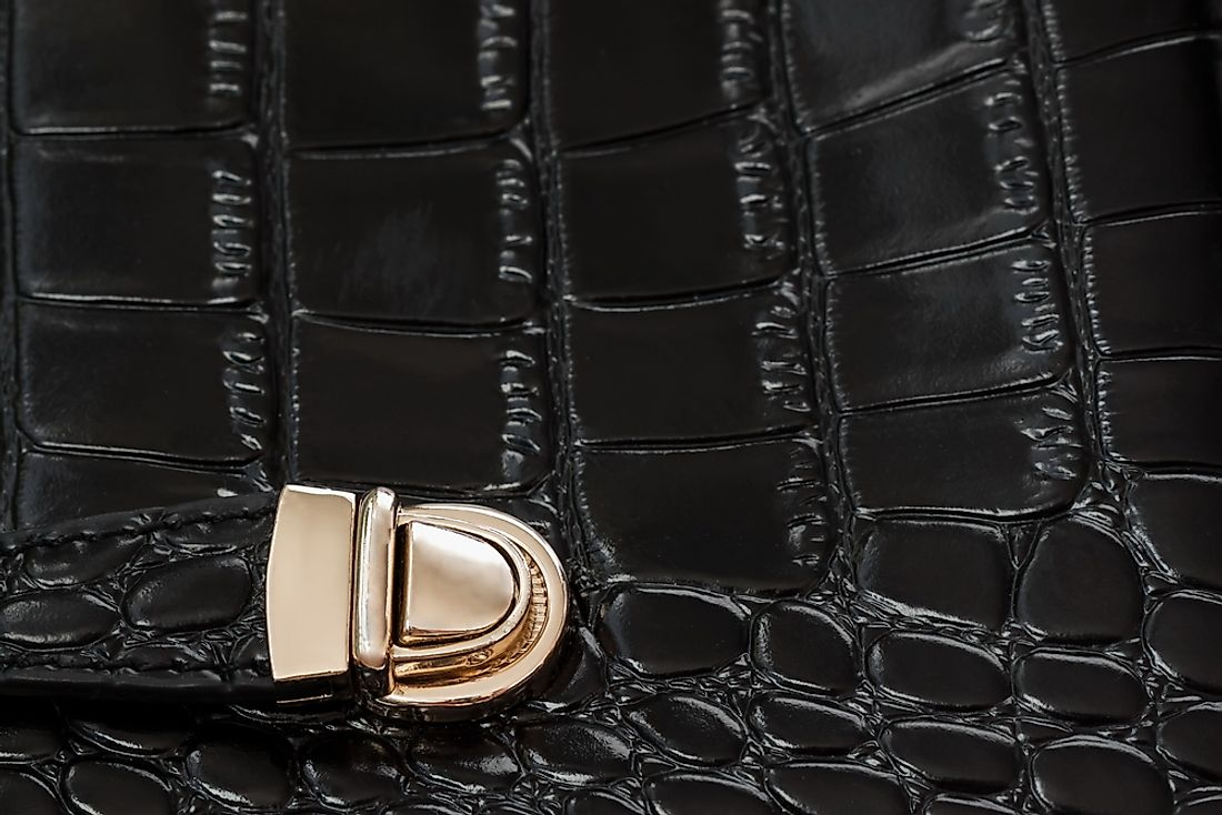 A black handbag made from repitl eskin.
