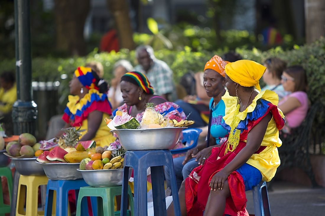 Colombian women sell fruit in the city of Cartagena, Colombia.  Editorial credit: Michel Piccaya / Shutterstock.com.