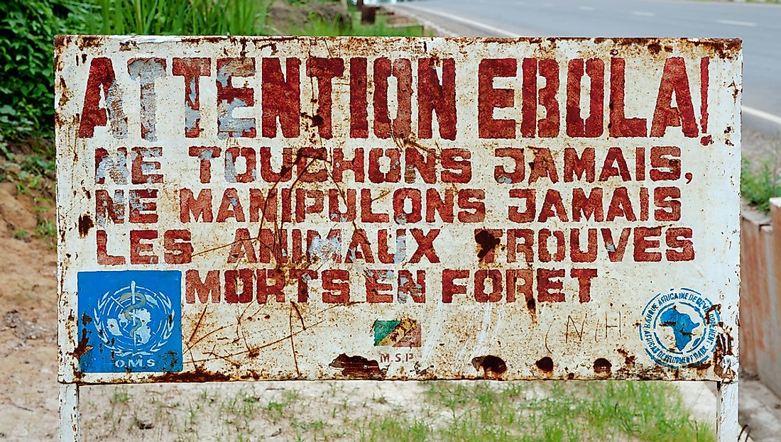 Sign in Congo warning that the area is infected with Ebola. Editorial credit: Sergey Uryadnikov / Shutterstock.com