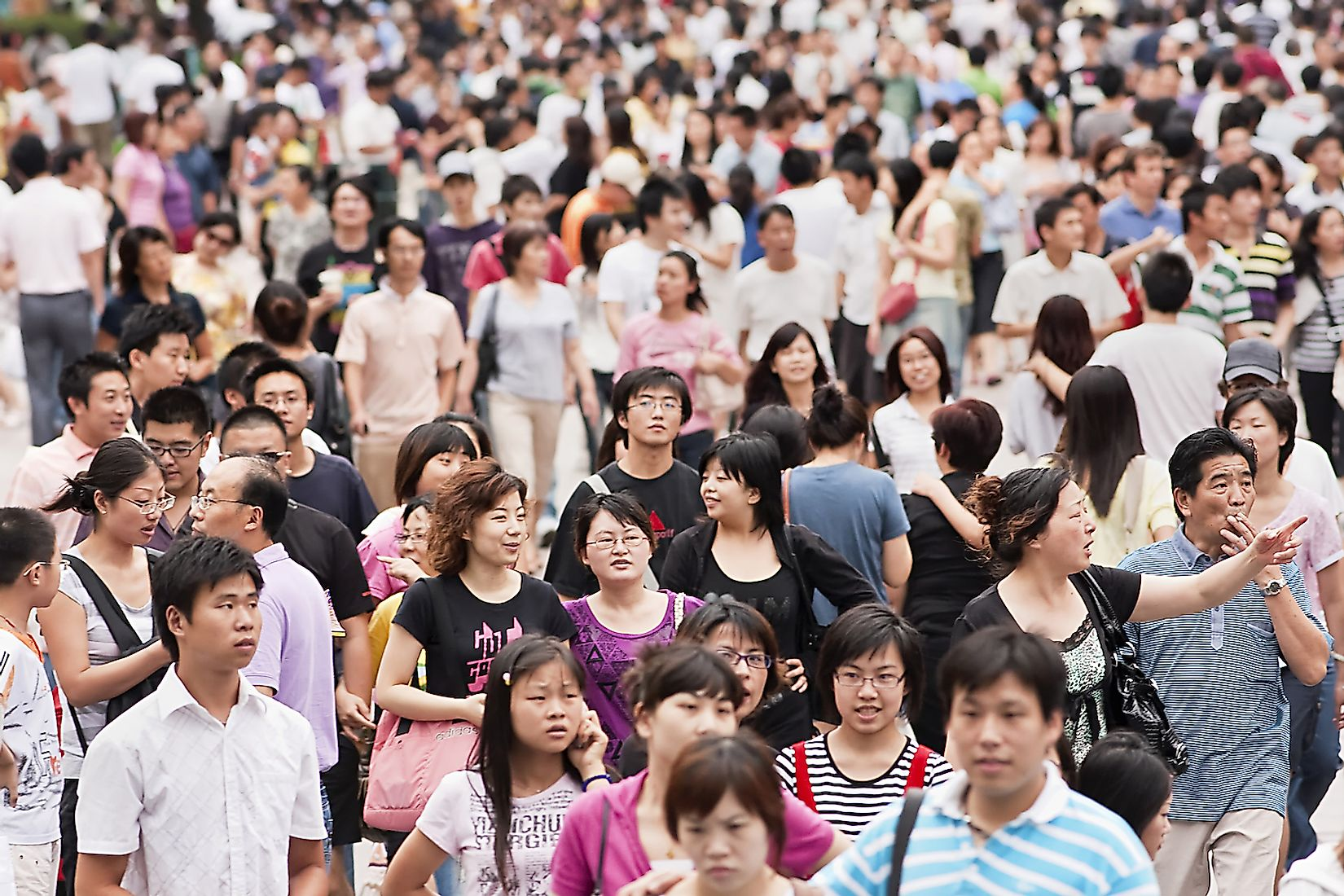 Crowd at Nanjing Road in Shanghai, China's most populated city. Image credit: TonyV3112/Shutterstock.com