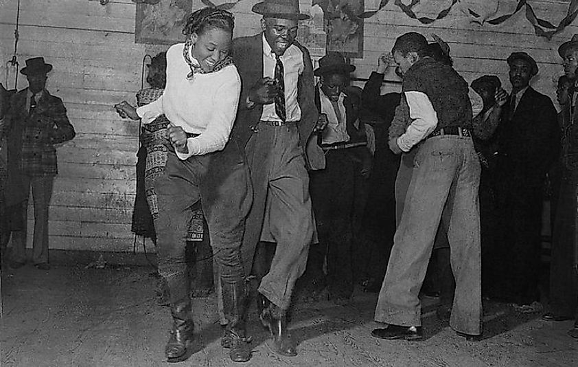 A young couple dancing the Jitterbug towards the end of the Great Depression.