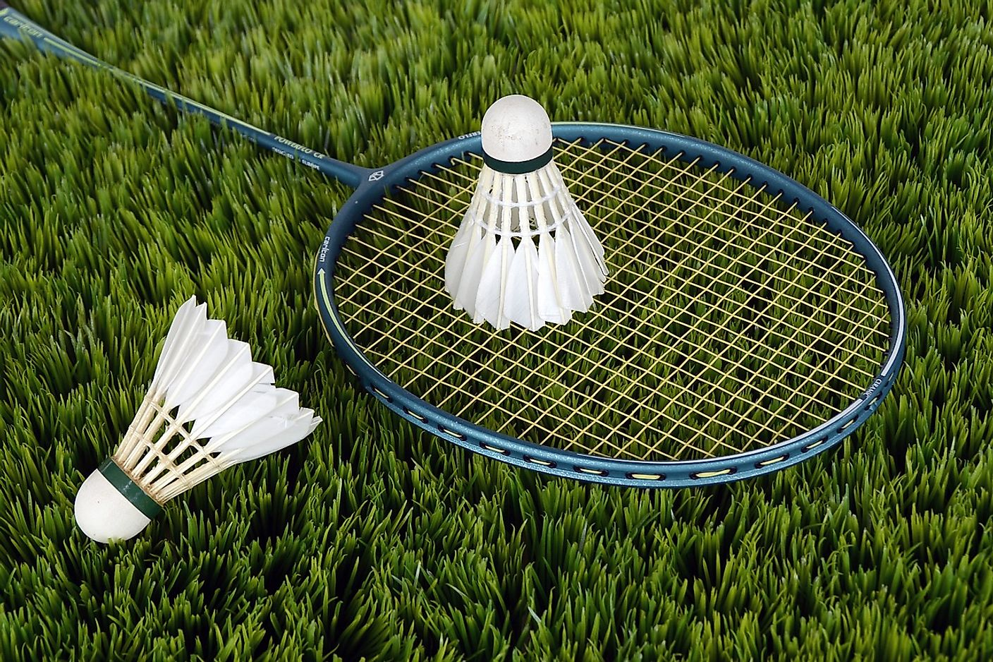 Badminton is played using a shuttlecock and racquet.