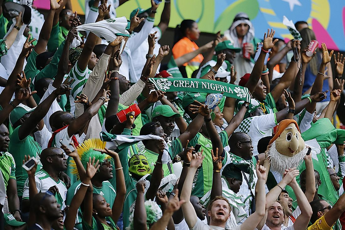 Fans of Nigeria national football cheer their team on. Editorial credit: AGIF / Shutterstock.com.