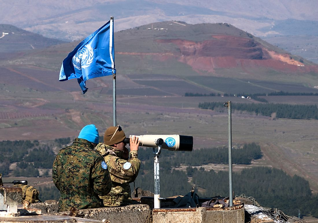 UN peacekeepers observing the Israel-Syria border. Editorial credit: StockStudio / Shutterstock.com