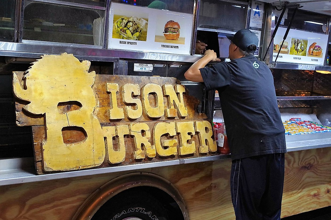 Man ordering a Bison Burger with a side of sprouts at the Bison all meat food truck. Image credit: joey  zanotti from Rancho Palos Verdes, CA, USA